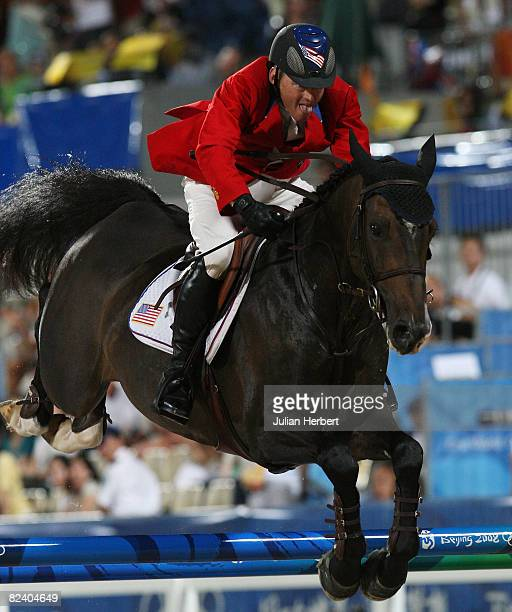 Will Simpson of the United States and Carlsson Vom Dach jump the last fence in the jump off against Canada during the Team Jumping Competition held...