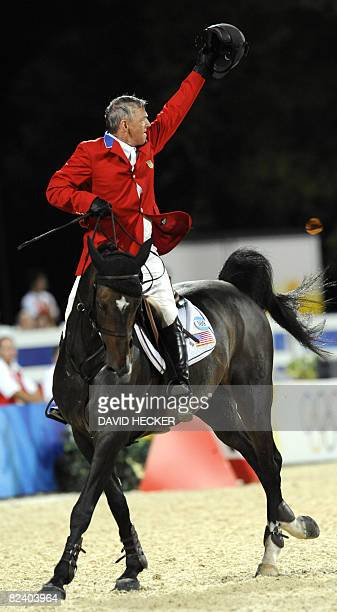 Will Simpson of the US waves riding Carlsson vom Dach during the Equestrian Jumping Individual competition of the 2008 Beijing Olympic Games in Hong...