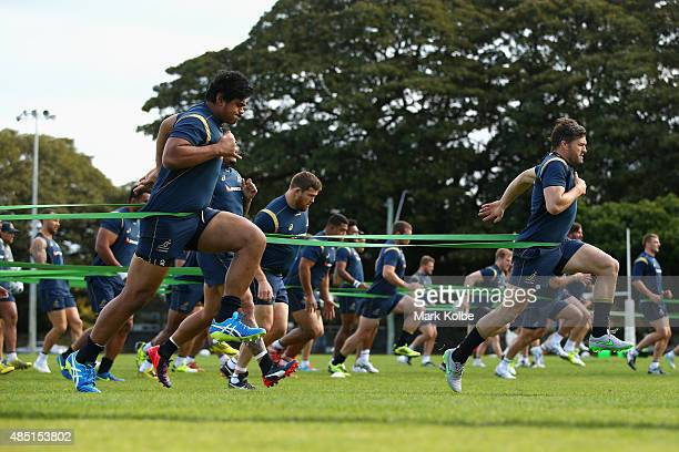 Will Skelton and Adam AshleyCooper runs with resistance bands during an Australian Wallabies training session at the Tramways Oval Moore Park on...