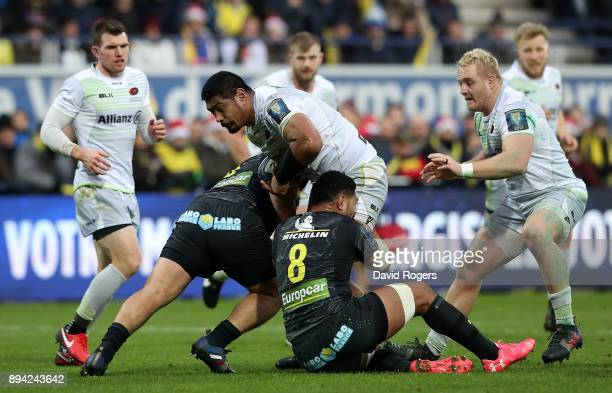 Will Skelton of Saracens is tackled by Fritz Lee of Clermont during the European Rugby Champions Cup match between ASM Clermont Auvergne and Saracens...