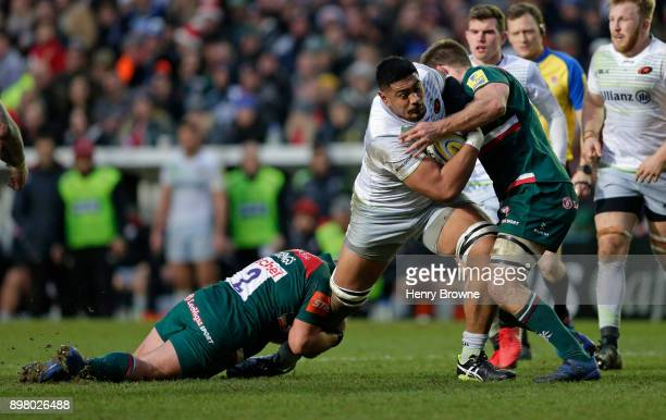 Will Skelton of Saracens tackled by Tom Youngs and Mike Fitzgerald of Leicester Tigers during the Aviva Premiership match between Leicester Tigers...
