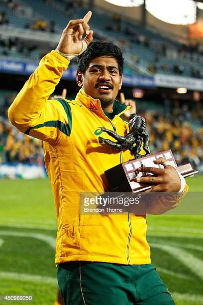 Will Skelton of the Wallabies holding the trophy for the 2014 Castrol Edge France tour celebrates following the International Test match between the...