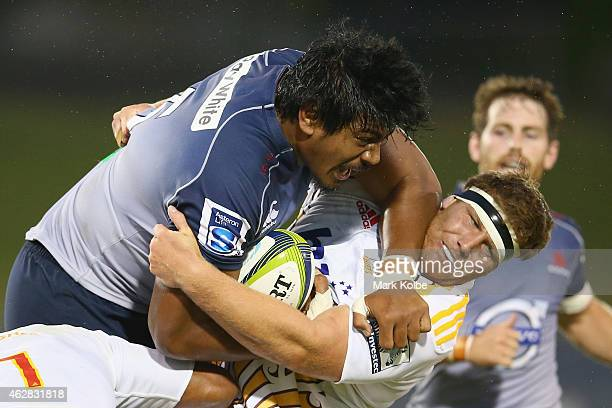 Will Skelton of the Waratahs is tackled by Mitchell Graham of the Chiefs during the Super Rugby trial match between the Waratahs and Chiefs at...