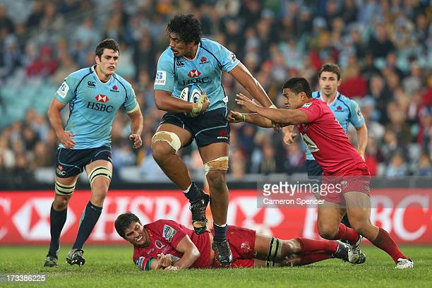 Will Skelton of the Waratahs is tackled during the round 20 Super Rugby match between the Waratahs and the Reds at ANZ Stadium on July 13, 2013 in...