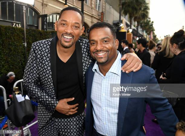 Will Smith and Alfonso Ribeiro attends the premiere of Disney's Aladdin at El Capitan Theatre on May 21 2019 in Los Angeles California