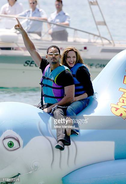 Will Smith and Angelina Jolie during 2004 Cannes Film Festival 'Shark Tale' Photocall at Carlton Beach Pier in Cannes France