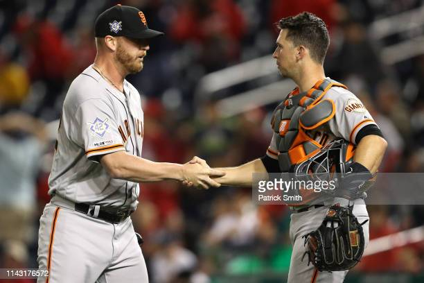 Will Smith and Buster Posey of the San Francisco Giants celebrate after defeating the Washington Nationals at Nationals Park on April 16 2019 in...