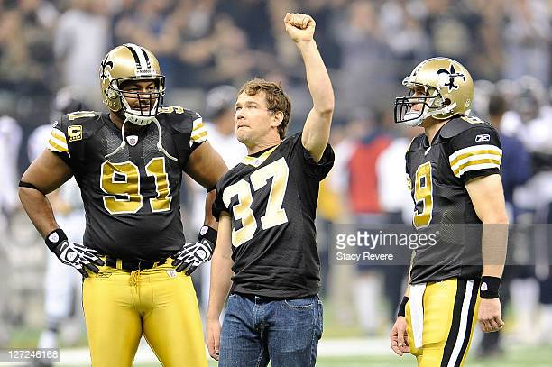 Will Smith and Drew Brees of the New Orleans Saints stand with former Saint Steve Gleason during a game at the Louisiana Superdome on September 25...