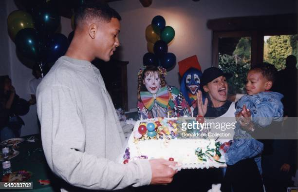 Will Smith and his wifeSheree Zampino hold their son Trey Smith at his second birthday party on November 14, 1992 in Los Angeles, California .