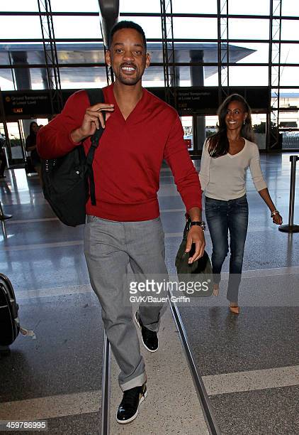 Will Smith and Jada Pinkett Smith are seen as they prepare to depart out of Los Angeles International Airport on December 30 2013 in Los Angeles...