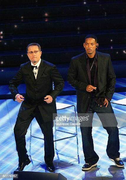 Will Smith and Paolo Bonolis dance on stage at the third day of the San Remo Festival at the Ariston Theatre on March 3 2005 in San Remo Italy The...