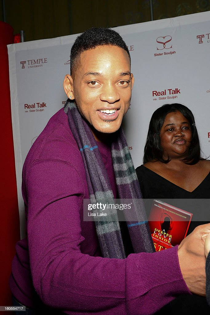 Will Smith and Sister Souljah pose on the red carpet during In Discussion: 'A Deeper Love Inside: The Porsche Santiaga Story' at Temple Performing Arts Center on February 2, 2013 in Philadelphia, Pennsylvania.