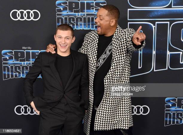 Will Smith and Tom Holland arrive at the premiere of 20th Century Fox's Spies In Disguise at El Capitan Theatre on December 4 2019 in Los Angeles...