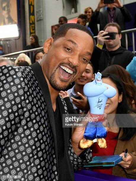 Will Smith arrives at the premiere of Disney's Aladdin at the El Capitan Theater on May 21 2019 in Los Angeles California
