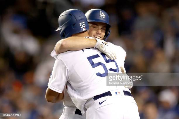 Will Smith celebrates his two run home run with Albert Pujols of the Los Angeles Dodgers against the San Francisco Giants during the eighth inning in...