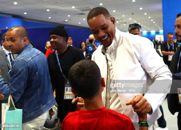 Will Smith cheers the mascots ahead of his opening ceremony performance, prior to the 2018 FIFA World Cup Final between France and Croatia at...