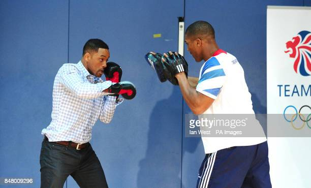 Will Smith doing pad work with Anthony Joshua GB Super Heavyweight boxer at the Ethos Sports Centre in Imperial College London