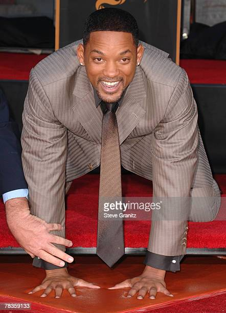 Will Smith is immortalized by placing his hands and feet in the cement at the world-famous Grauman's Chinese Theatre