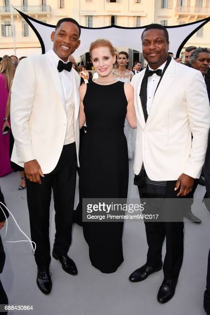 Will Smith Jessica Chastain and Chris Tucker arrive at the amfAR Gala Cannes 2017 at Hotel du CapEdenRoc on May 25 2017 in Cap d'Antibes France