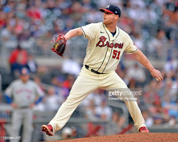 Will Smith of the Atlanta Braves pitches during a game against the New York Mets at Truist Park on October 3, 2021 in Atlanta, Georgia.