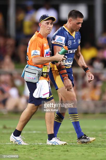 Will Smith of the Eels leaves the field with the trainer during the round seven NRL match between the Parramatta Eels and the Brisbane Broncos at TIO...