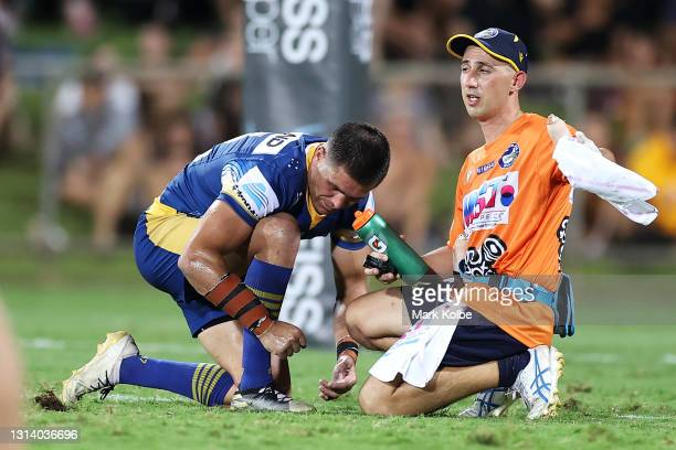 Will Smith of the Eels receives attention from the trainer during the round seven NRL match between the Parramatta Eels and the Brisbane Broncos at...