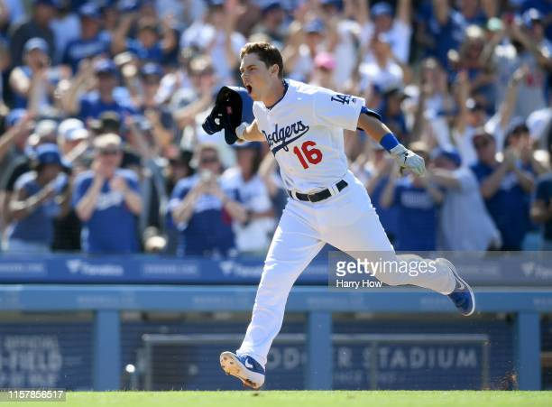 Will Smith of the Los Angeles Dodgers celebrates his walk-off two run homerun, for a 5-3 win over the Colorado Rockies, during the ninth inning at...