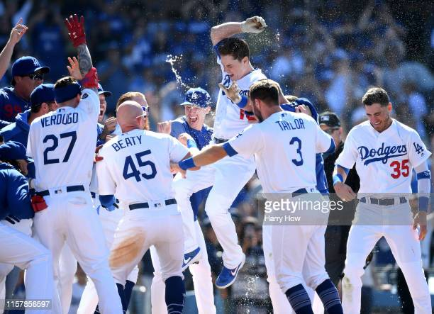 Will Smith of the Los Angeles Dodgers jumps at home plate in celebration of his walk-off two run homerun, for a 5-3 win over the Colorado Rockies,...