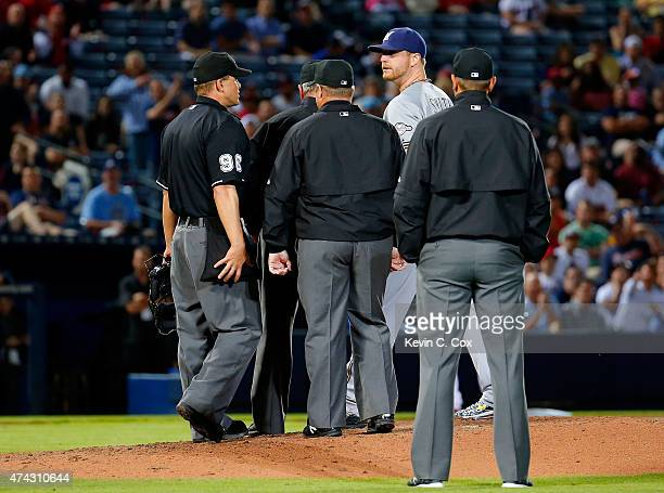 Will Smith of the Milwaukee Brewers is ejected by second base umpire Jim Joyce in the seventh inning against the Atlanta Braves at Turner Field on...