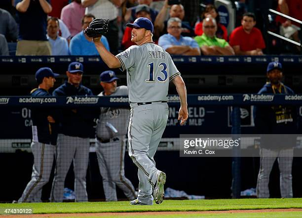 Will Smith of the Milwaukee Brewers walks off the field after being ejected by second base umpire Jim Joyce in the seventh inning against the Atlanta...