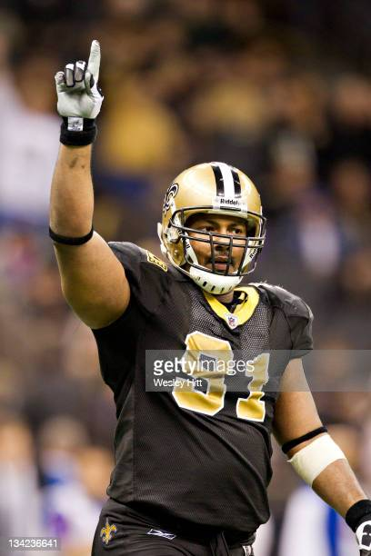 Will Smith of the New Orleans Saints shows who is number one after a game against the New York Giants at MercedesBenz Superdome on November 28 2011...
