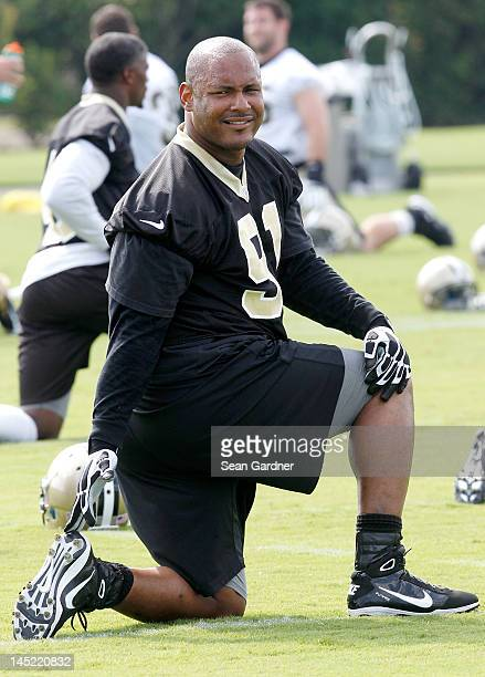 Will Smith of the New Orleans Saints stretches during OTA's at the Saints Training Facility on May 24 2012 in Metairie Louisiana