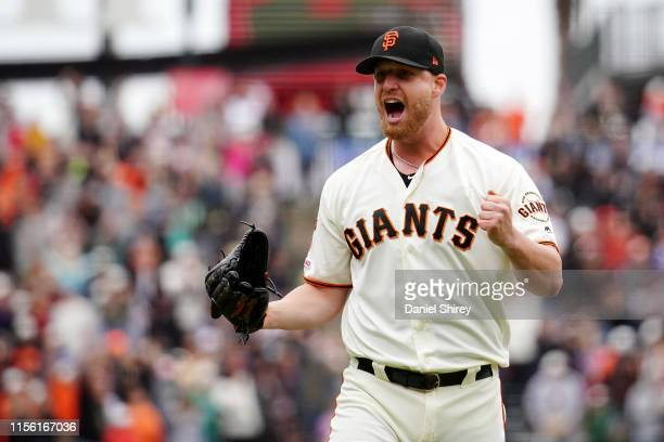 Will Smith of the San Francisco Giants celebrates beating the Milwaukee Brewers and getting the save at Oracle Park on June 15 2019 in San Francisco...