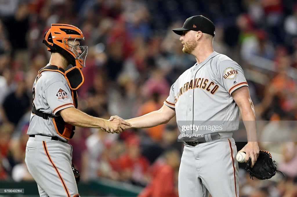 Will Smith #13 of the San Francisco Giants celebrates with Buster Posey #28 after a 9-5 victory against the Washington Nationals at Nationals Park on June 8, 2018 in Washington, DC.