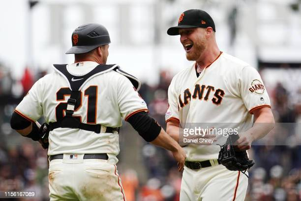 Will Smith of the San Francisco Giants celebrates with Stephen Vogt after beating the Milwaukee Brewers and getting the save at Oracle Park on June...