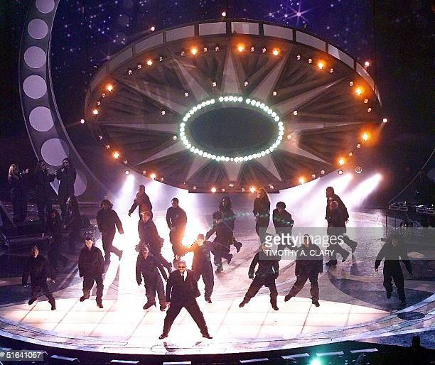 """Will Smith performs his hit song """"Men in Black"""" as a space ship lands on the stage to open the 40th Grammy Awards at Radio City Music Hall in New..."""
