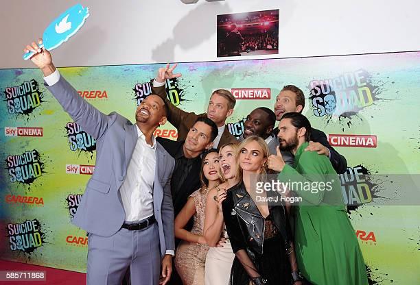 Will Smith poses for a selfie with Jay Hernandez, Joel Kinnaman, Adewale Akinnuoye-Agbaje, Jai Courtney, Jared Leto, Cara Delevingne, Margot Robbie...