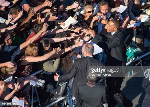 Will Smith poses for selfies with fans as he attends the 'Ismael's Ghosts ' screening and Opening Gala during the 70th annual Cannes Film Festival at...