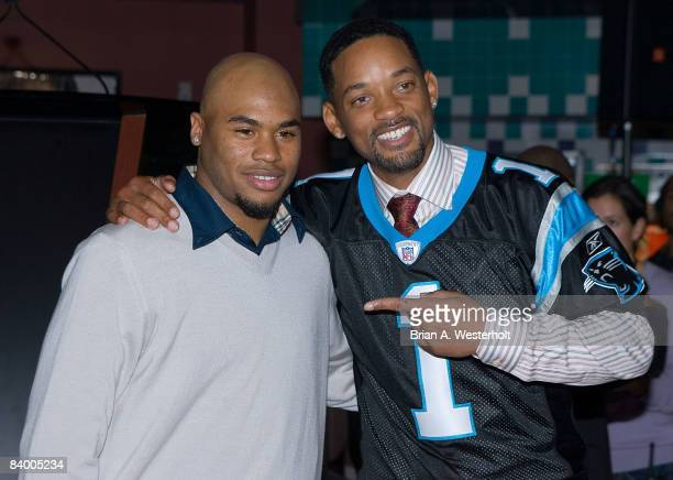 Will Smith poses with Carolina Panthers wide receiver Steve Smith at the premiere of Seven Pounds at the Regal Stonecrest on December 11 2008 in...