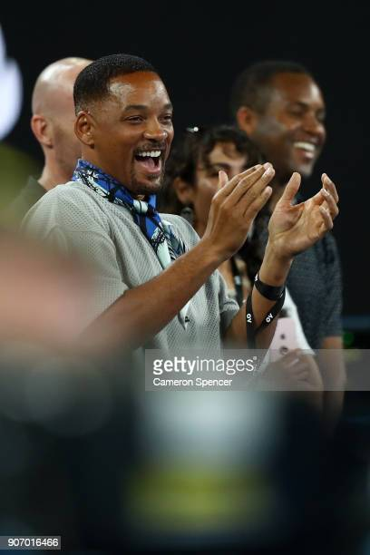 Will Smith reacts as Nick Kyrgios of Australia is interviewed on court after winning his third round match against JoWilfried Tsonga of France on day...