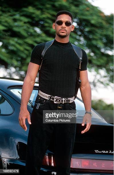 Will Smith standing with sunglasses on in a scene from the film 'Bad Boys' 1995