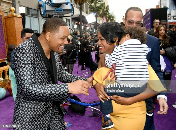 Will Smith Tatyana Ali Edward Aszard Rasberry and Vaughn Rasberry arrive at the premiere of Disney's Aladdin at the El Capitan Theater on May 21 2019...