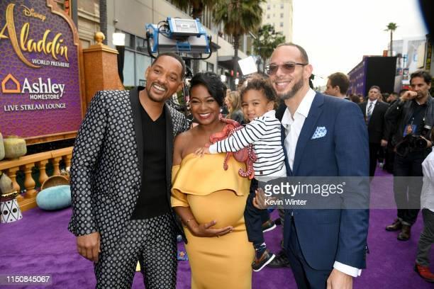 Will Smith Tatyana Ali Edward Aszard Rasberry and Vaughn Rasberry attend the premiere of Disney's Aladdin at El Capitan Theatre on May 21 2019 in Los...
