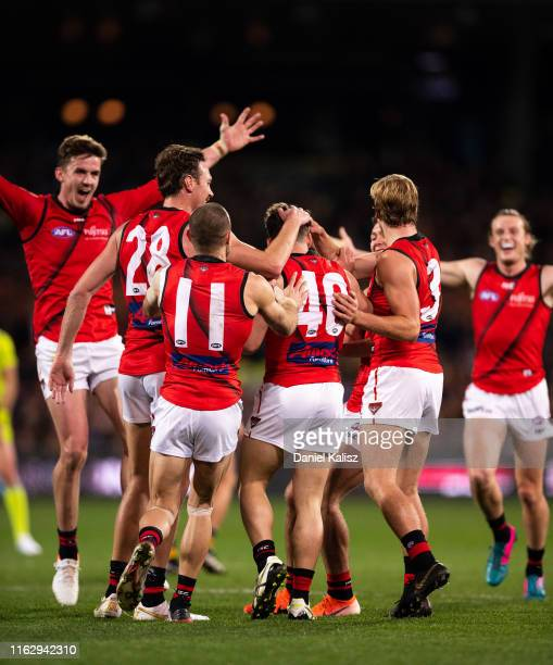 Will Snelling of the Bombers celebrates with his team mates after kicking a goal during the round 18 AFL match between the Adelaide Crows and the...