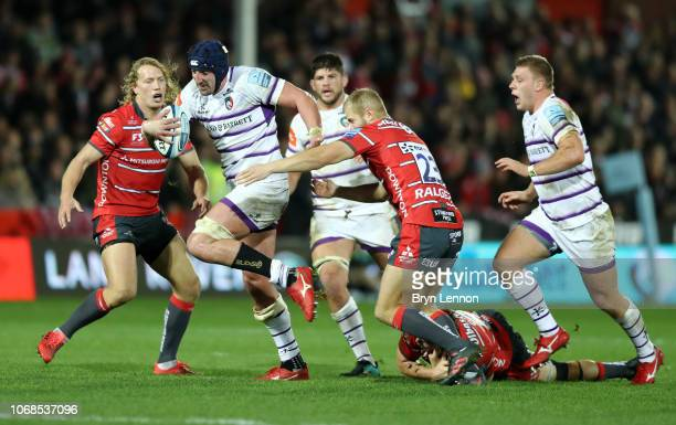 Will Spencer of Leicester Tigers breaks through the tackle of Tim Hudson and Billy Twelvetrees of Gloucester during the Gallagher Premiership Rugby...