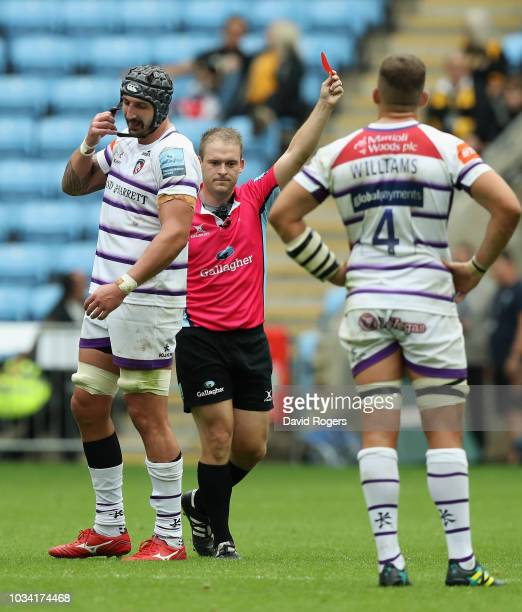 Will Spencer of Leicester Tigers is sent off by referee Ian Tempest after a high tackle on Tommy Taylor during the Gallagher Premiership Rugby match...