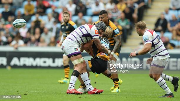 Will Spencer of Leicester Tigers is sent off by referee Ian Tempest after this high tackle on Tommy Taylor during the Gallagher Premiership Rugby...