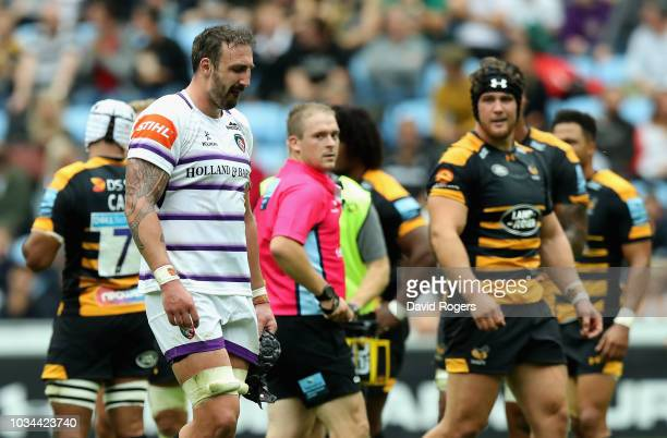 Will Spencer of Leicester Tigers walks off the field after being sent off by referee Ian Tempest after a high tackle on Tommy Taylor during the...