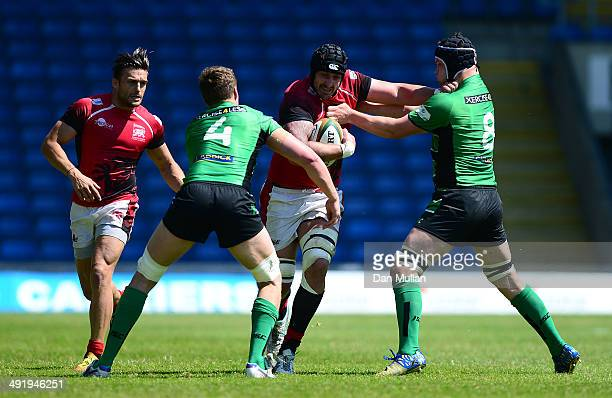 Will Spencer of London Welsh is tackled by Richard Beck and Ryan Burrows of Leeds Carnegie during the Greene King IPA Championship Semi Final match...