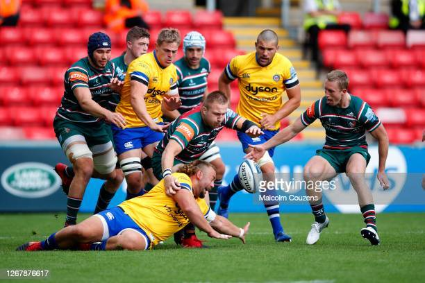 Will Stuart of Bath Rugby competes for the ball with Joe Heyes and Harry Potter of Leicester Tigers during the Gallagher Premiership Rugby match...